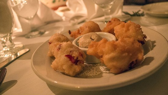 Manchester, VT: Every evening starts with our famous Cranberry Fritters with Maple Butter.