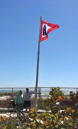 Boca Grande, FL: Chuck and Tom raising the Lighthouse Service Pennant.