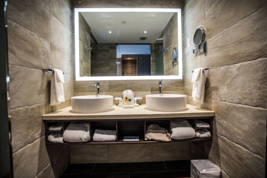Bimini: Spacious accommodation feature large modern bathrooms with walk-in showers and double sink vanit