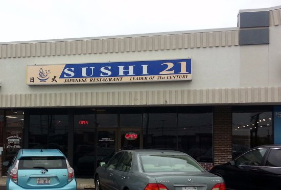 front of & entrance to Sushi 21
