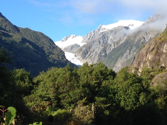 Misty Peaks: View of Fox Glacier from outside our room