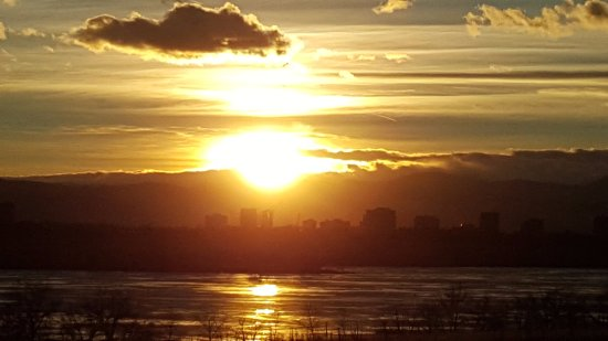 Aurora, CO: Sunset across Cherry Creek Lake, shadows of Denver with Rocky Mts in distance!
