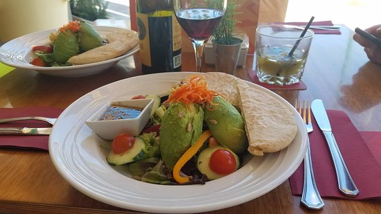 Mocubar: avocado and hummus salad with warm pita