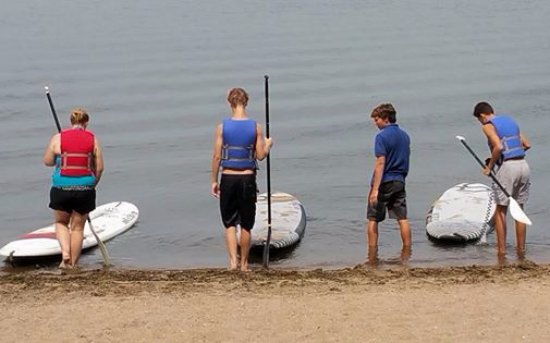 Maple Plain, MN: My kids and their friend getting a quick lesson before going out on the paddle boats.