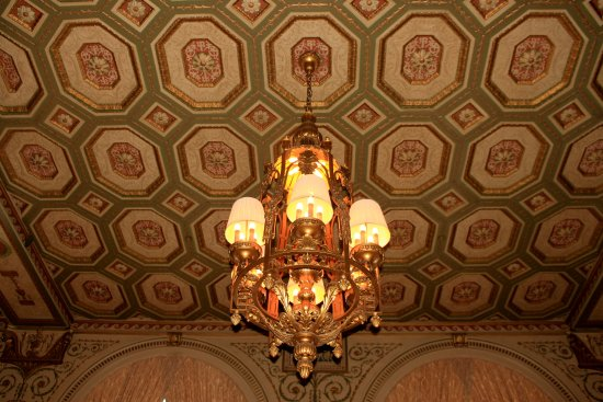 Ornate Lighting Fixture And Detailed Design On Ceiling