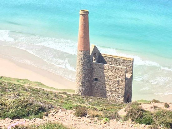 St Agnes, UK: Wheal Coates mine (in part) with sea and beach view below