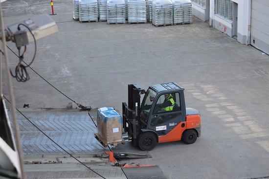 Stokmarknes, Norway: Unloading cargo