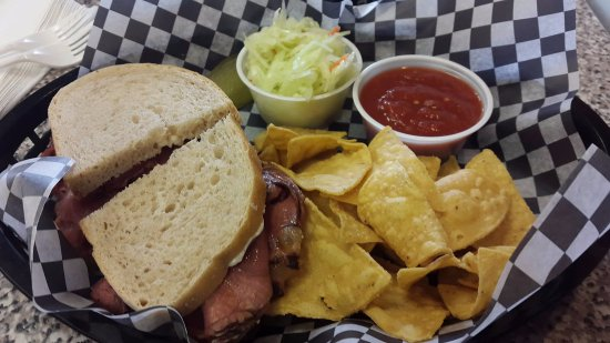 Ajax, Canada: Smoked meat sandwich on light rye with nachos and salsa + coleslaw