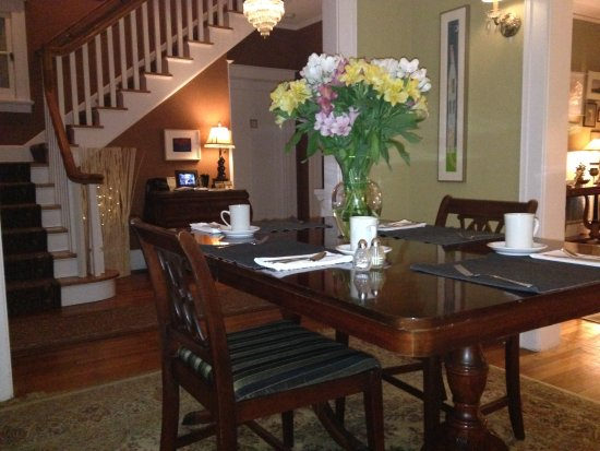 Brown Street Inn : Table set for breakfast with reception area behind.