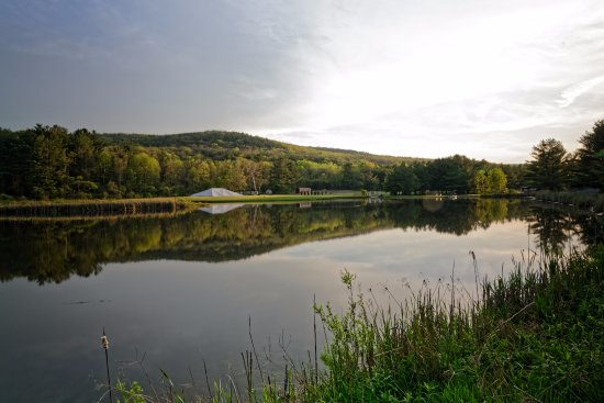 Hammondsport, NY: Looking across the pond, the event tent is just going up for the season