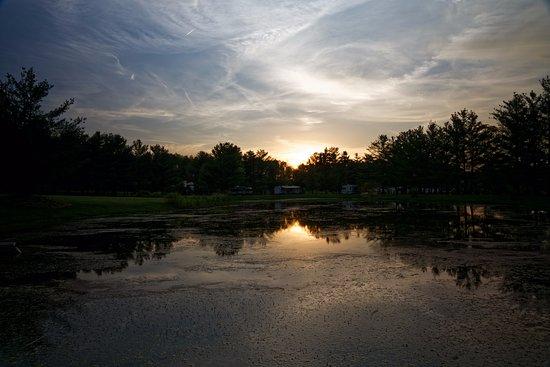 Hammondsport, NY: Sun setting over pond