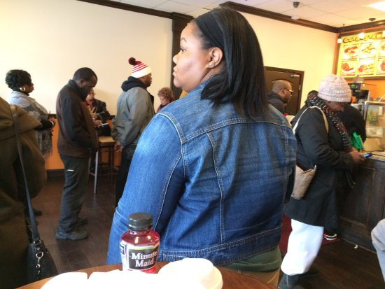 Decatur, GA: Customers in line to place order for breakfast