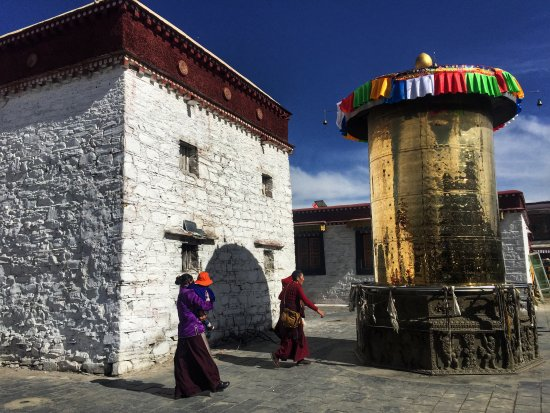 Nedong County, China: Prayer wheel in front of the monastery..