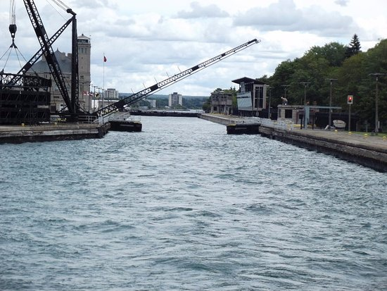 Soo Locks : Leaving the locks with water full to the top. Viewing tower on the right side.