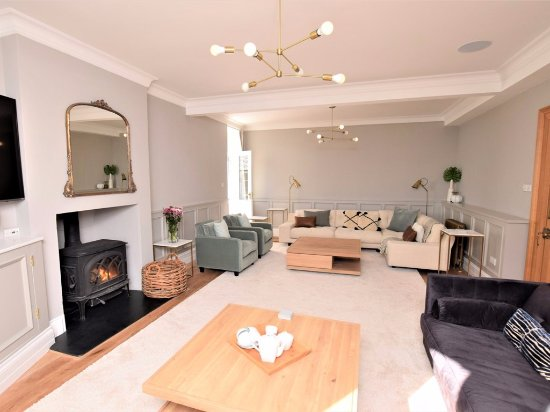 Cury, UK: The living room with log burner and Sky TV