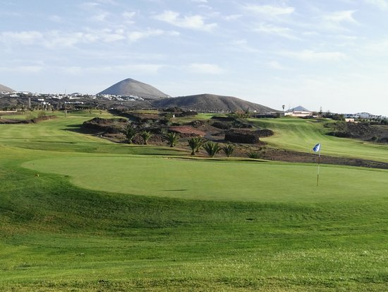 Lanzarote Golf Resort: Ancient stone walls, more than 200 years old, vulcan  at the back at the back and a beautiful gr