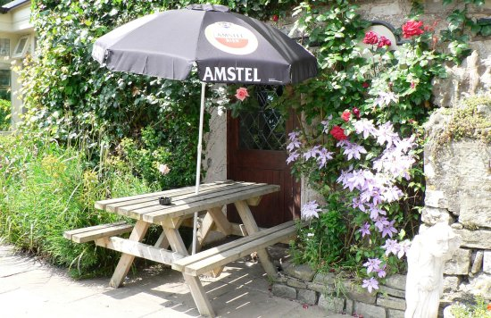 Tintern, UK: Typical Outside Dining Table amidst summer flowers!