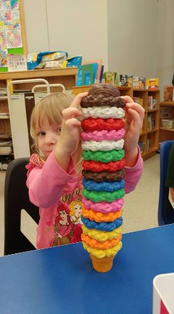 Chatham, Canada: My daughter playing with the ice cream toy at the library.