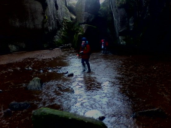 Dinnet, UK : the kids having fun in the cave
