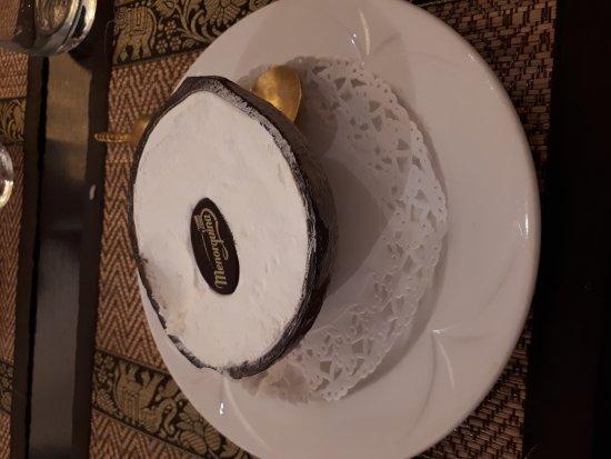 Newmarket, UK: Coconut ice cream, in a half coconut