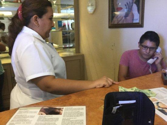 Fiesta Americana Merida: Employees on the phone with Fiesta management