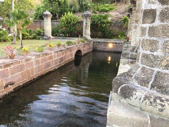 English Harbour, Antigua: a waterway between greenstone pillars