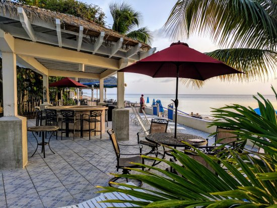 Sand Castle on the Beach: The pool bar and patio with the beach side restaurant in the background all overlooking the ocea