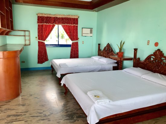 San Andres, Philippines: Family room, A/C, beach front, P2000 pax of 5. Check in @12pm/check out @11am