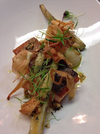 Grilled Salmon textures of parsnip, capers & hazelnut vinaigrette