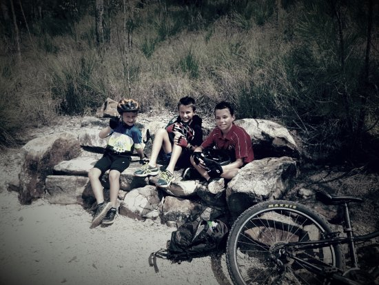 Kids taking a break on Atherton MTB trails.