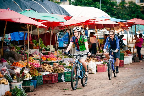 Pakse, Laos: Local market with tropical fruit