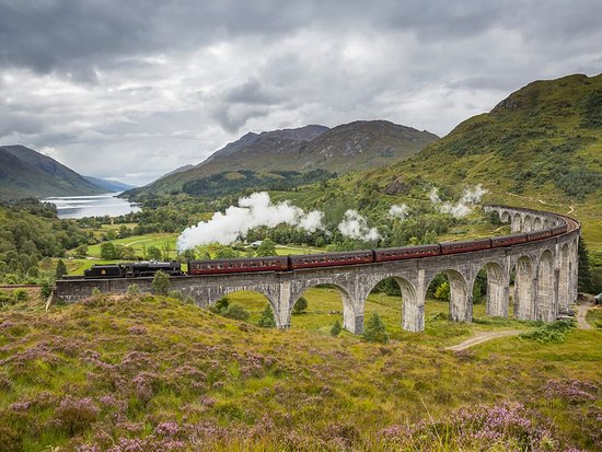Fort William, UK : The Jacobite steam train passing over the Glenfinnan Viaduct