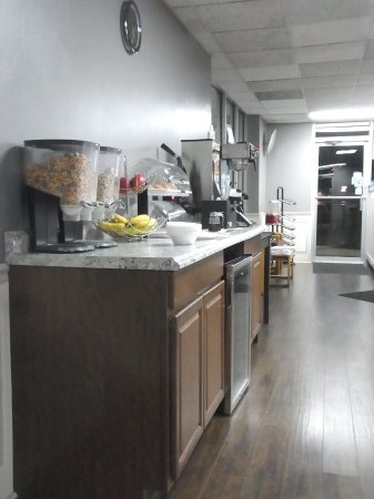 Gallipolis, OH: Breakfast area, with cereal, fruit, waffle maker. Milk and juice were below.