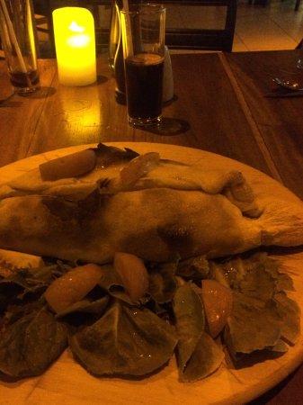 Prego Italian Restaurant: Italian sausage and blue cheese calzone, huge !