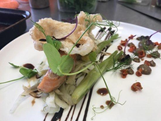 Wakefield, New Zealand: confit salmon, shaved fennle, black garlic and pork skin puffs