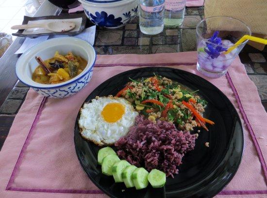 San Sai, Thailand: Massaman curry (in bowl) and stir-fried pork with holy basil and a crispy fried egg.