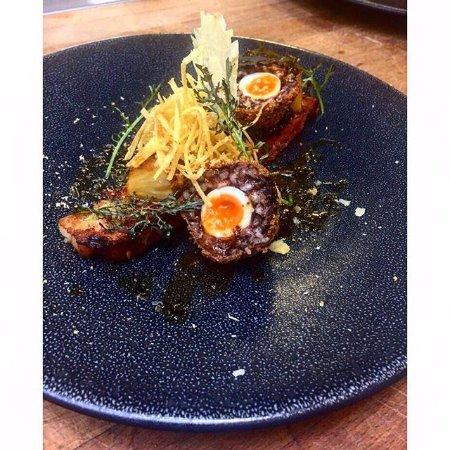Corsham, UK: Smoked pork belly, black pudding arancini, bbq pineapple, bacon jam, grated egg yolk