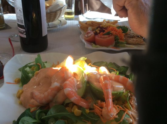 Maro, Spain: This is prawn and avocado salad with lovely bottle of red