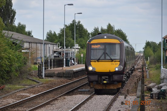 Whittlesey, UK: Cross Country train approaching platform and crossing