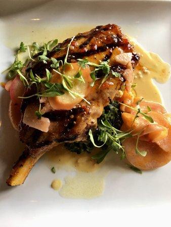 Clifton, Техас: Bone in pork chop with Bourbon Dijon sauce, crab apples and sautéed greens
