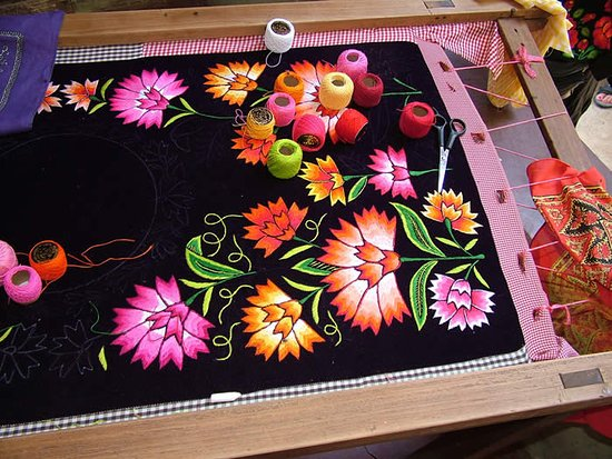 Martinez, CA: Embroidery frame to stitch flowers on a velveteen huipil or traditional blouse; Oaxaca, MEXICO.