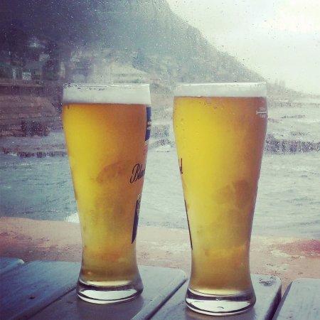 Kalk Bay, Sør-Afrika: Having beer 'on top of the ocean' at Brass Bell.