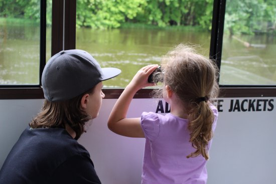 On the river, Winona Tour Boat looking at turtles with provided binoculars
