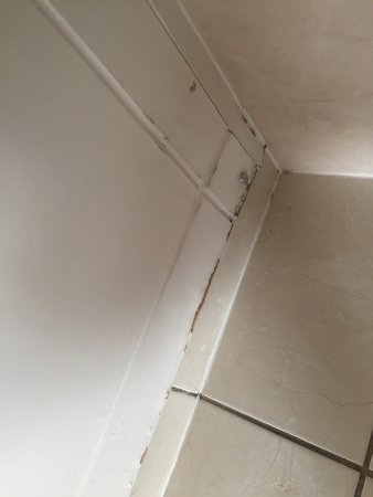 Polmont, UK: Evidence of a very dirty room requiring upgrade including bulge in bathroom ceiling and torn cur