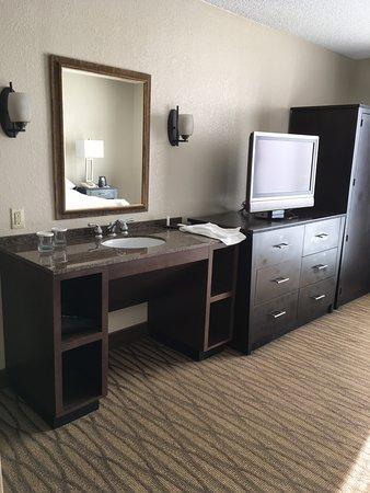 Miami Springs, FL: Bathroom sink outside bathroom next to TV, Strange!