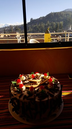 Morales Guesthouse: Surprise birthday cake from the owner and great view behind
