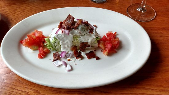 Buckley's in Merrimack, NH. Wedge Salad with blue cheese (also available with ranch dressing)