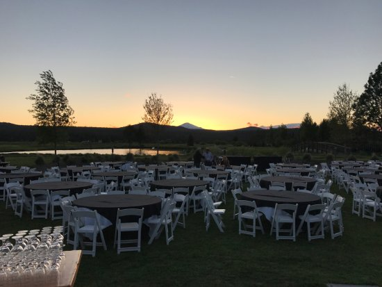 Sunriver, OR: View from reception behind main lobby with sunset behind Bachelor