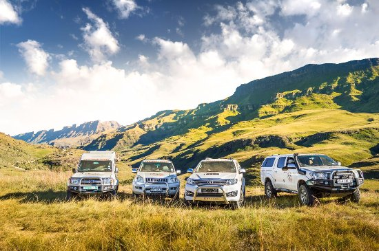 Underberg, South Africa: A few of our Vehicles - what an awesome backdrop