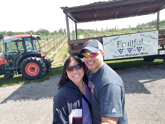 Fruitful Vine LLC: Our Wine O Wagon pulled by a tractor